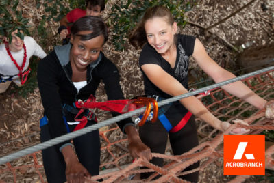 Acrobranch Cape Town two young women climbing cargo nets
