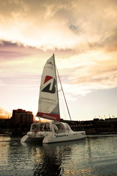 Ameera Sailing Catamaran in harbour and sun is setting