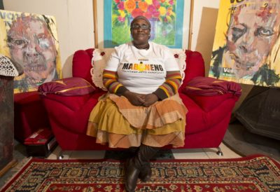 The Maboneng Township Arts Experience lady sitting in lounge with art around her