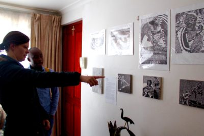 The Maboneng Township Arts Experience black and white drawings on the wall
