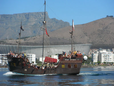 Jolly Roger Pirate Ship boat with cape town stadium in background