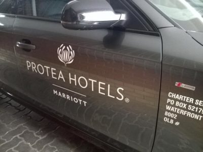 MLT Shuttle Service Car with Protea hotel branding on it