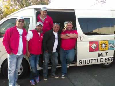 MLT Shuttle Service male staff and drivers at shuttle bus