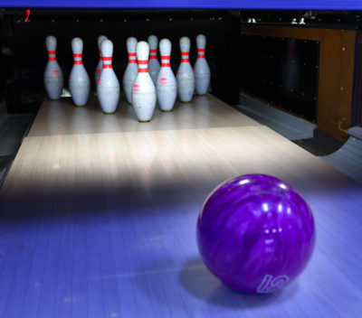 Magic Bowling purple bowling ball on its way to tenpins