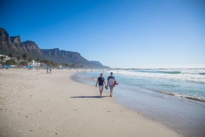 Camps Bay Beach two men walking on beach